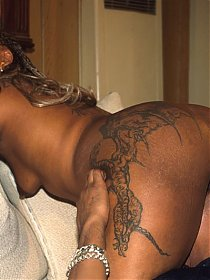 Tattooed chick with a big black ass gets nailed