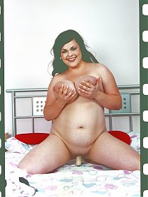 Big housewife with huge melons playing with her toys