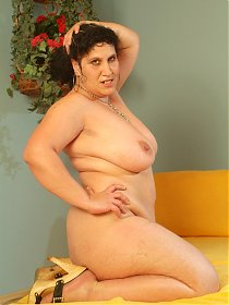 Mature BBW Laszlone does a striptease in front of a younger guy to lure him into lending her his dick