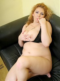 Horny BBW Luana swallowing a juicy wick before cramming it into her fat covered muff